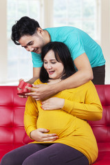 Happy pregnant mother getting a surprise gift