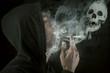 Man smoking over a black background