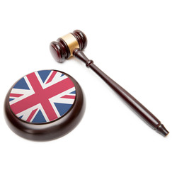 Judge gavel and soundboard with flag on it - United Kingdom