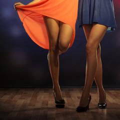 Female legs dancing in club