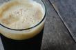 Pint of Dark Beer on Wood Background - 75915260