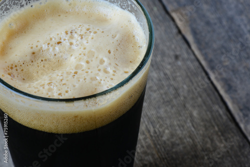 Pint of Dark Beer on Wood Background - 75915260