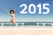 Woman in bikini with number 2015