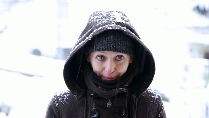 a beautiful woman gets snowballs in her face
