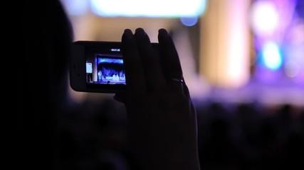 Shooting  camera phone holiday in a dark hall