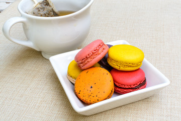 Colorful macaroons and a cup of tea