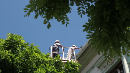 Maintenance Workers Working at Height
