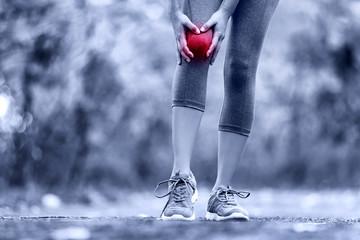 Knee Injury - sports running knee injuries on woman