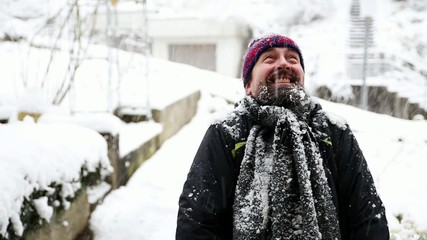 a funny man gets snowballs in his face