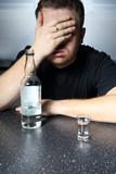 Alcohol problem - helpless man drinking vodka poster