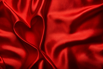 Heart shape silk fabric folds. Valentine day red background.