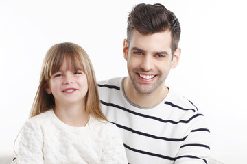 Happy young father and his daugther