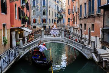 Venice, Italy - Gondolier and ballerina