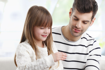Young father and his daugther
