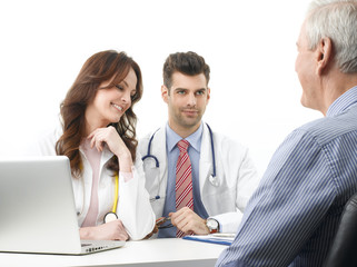 Medical discussion at hospital with elderly patient