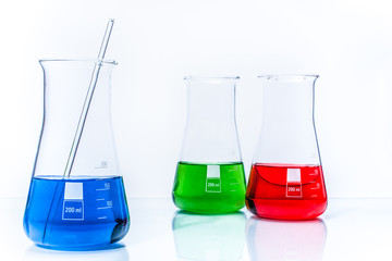 Set of three conical temperature resistant flasks with color liq