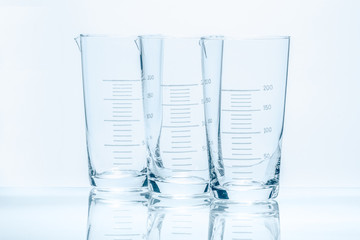 Set of three empty temperature resistant conical beakers for mea