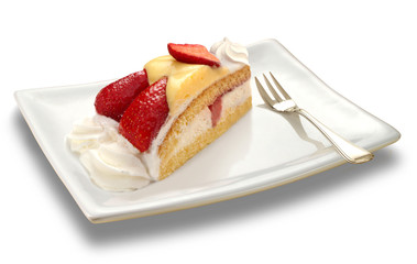 slice of a strawberry cake on white plate