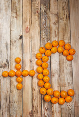 Vitamin C of tangerines on a wooden table