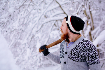 Lumberjack in the snowy winter forest