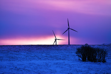 wind driven electric plant in firstlight in winter