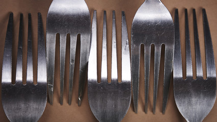 Forks on a brown paper background