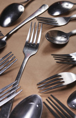 Fork and spoon on a paper background