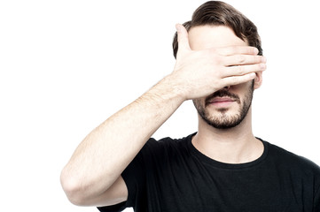 Man making see no evil gesture