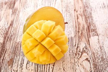 Mango fruit on wood