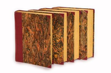 Four old antique books.
