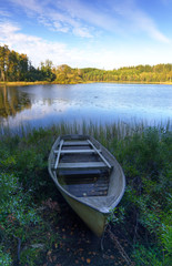 Old boat on Swedish lake coast