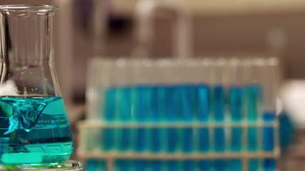 Blue chemical swirling in beaker