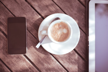 cup of coffe tablet and smart phone