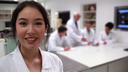 Pretty medical student smiling at camera in class