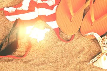 orange sandals and shells