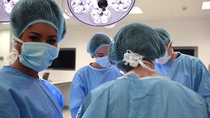 Surgical team working together in operating theater