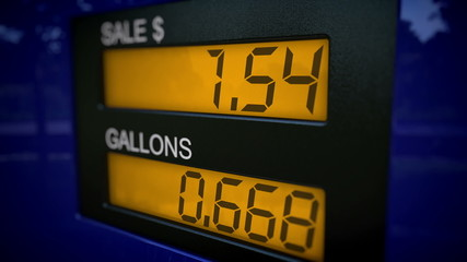 Zoom in on gas pump display with rising numbers starting at zero