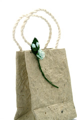 Brown mulberry paper bag isolated with flower