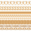 Assorted golden chains on white background.