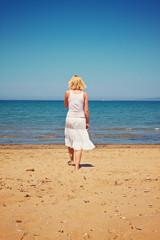 summer holidays - woman at beach take a walk