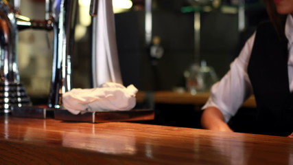 Bartender in uniform cleaning