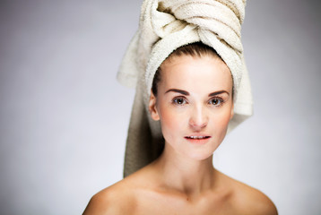 Fresh and healthy model girl with on towel head