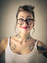 Tattooed girl smiling
