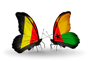 Two butterflies with flags Belgium and Guinea Bissau
