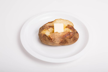 Hot Buttered Baked Potato on White Plate and Background