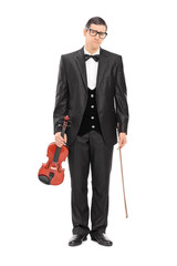 Full length portrait of a sad musician holding a violin