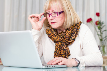 Woman concentrated working with her computer
