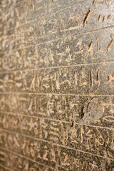 Egyptian hieroglyphics on stone relief close up
