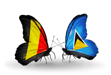 Two butterflies with flags Belgium and Saint Lucia