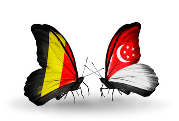 Two butterflies with flags Belgium and Singapore